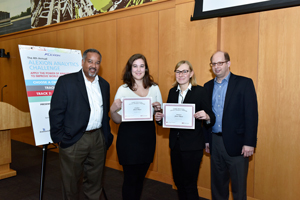 George Llado and David Schuff pose with the winners of the 4th Annual Temple Analytics Challenge.